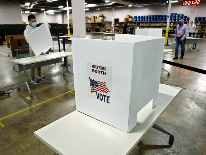 An elections worker sets up voting booths at the Franklin County Board of Elections for early voting in 2020.
