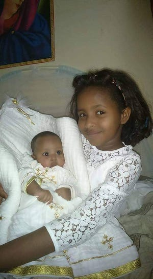 Semere Tesfatsion, a refugee from Eritrea living in Whitehall, shares his favorite photo of his young daughters, whom he has been living separately from for four years while he waits to be reunited with them through the refugee resettlement program. On Wednesday night, the Trump administration informed Congress it intends to accept a maximum of 15,000 refugees this fiscal year, a new historic low.