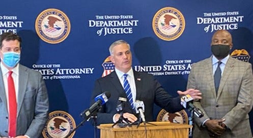 Scott W. Brady, U.S. Attorney for the Western District of Pennsylvania, center, speaks Wednesday, Sept. 30, 2020, at a press conference announcing arrests in connection with a major drug trafficking ring in western Pennsylvania that investigators say was headed by a Columbus man.  Josh Lamancusa, district attorney for Lawrence County, Pennsylvania, is at left, and Paris Pratt, assistant special agent in charge of Drug Enforcement Administration's Philadelphia office is at right.