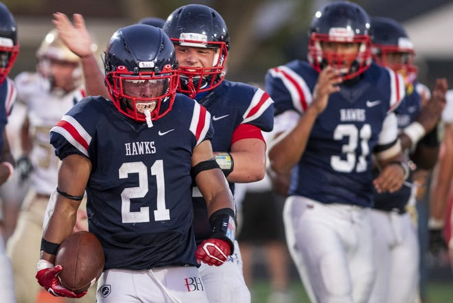 Running back Nyal Johnson (21) and the rest of the Hartley Hawks look to avenge a defeat to DeSales earlier this season. [Gaelen Morse/Dispatch]