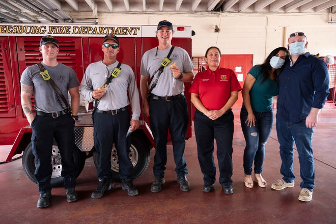 My Cookie World owner, Juna Jarrett, and her husband, Andy, donated hundreds of their signature half-pound cookies to the Leesburg Fire Department last week as part of their six week mission to donate to local first responders. [Cindy Peterson/Correspondent]