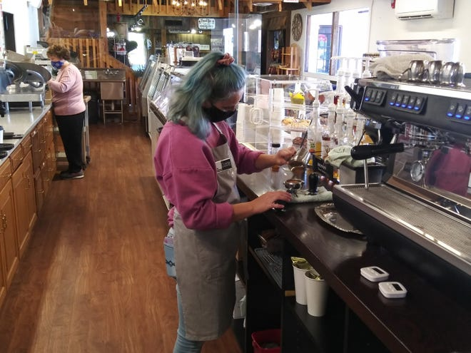 Barista Cozette Torrence prepares a latte for a customer at the new Corner Cup coffee shop in Wilmot.