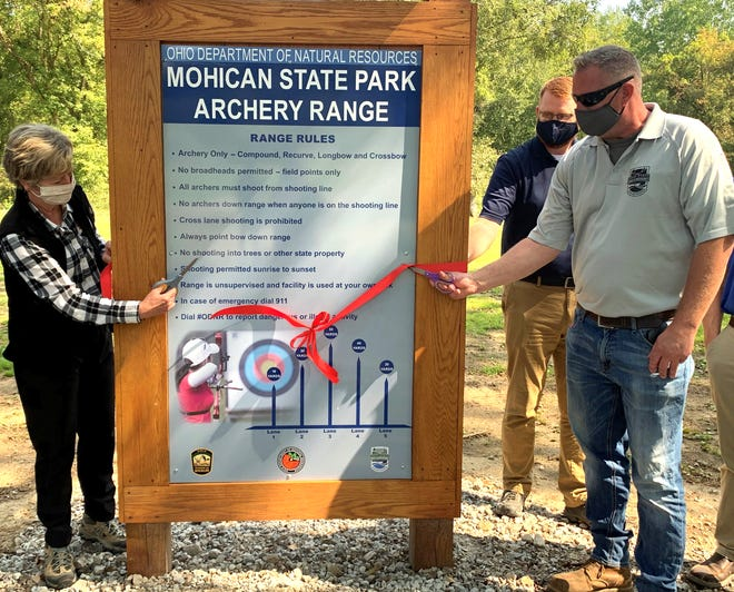 Ohio Department of National Resources Director Mary Mertz cuts the ribbon on the new archery range in Loudonville on Mohican State Park land.