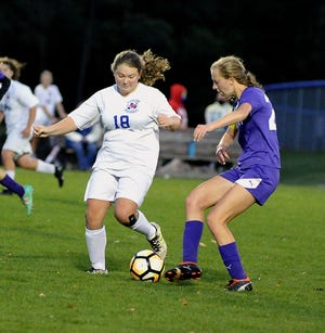 Triway's Shari Richie redirects this ball in front of Tuslaw's Emma Kindy. Richie scored two goals in the first half.