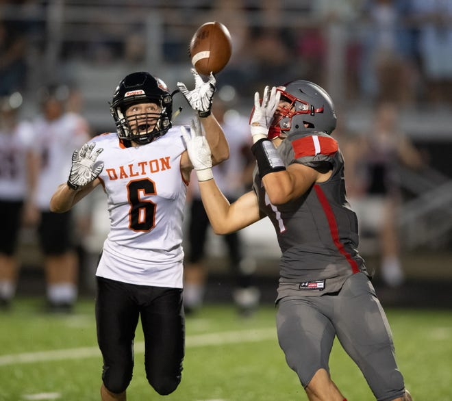 Dalton's Owen Beatty and Norwayne's Noah Saal battle over pass during last year's game between the two league rivals. Dalton won 29-14.