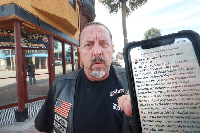 Rick Sessa, co-owner of Smokey's Cigar Bar on Main Street and national president of the Enforcers Motorcycle Club, upset that the city has put limits on Biketoberfest, holds his cellphone, Wednesday, Sept. 30, 2020, showing one of many social media posts encouraging bikers to attend Biketoberfest.