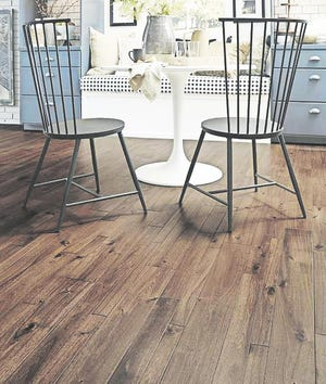 Bengal Bay Coffee hardwood flooring shows off a hand-scraped texture and variegated stain popular in contemporary spaces.