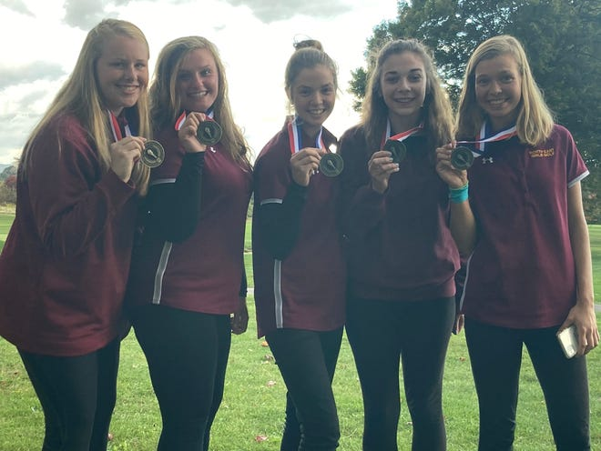 North East's Ellise Sebolt, from left, Taylor Urban, Anna Swan, Claire Dodds and Lydia Swan display their championship medals after the Grapepickers won the District 10 Class 2A girls golf title Thursday at The Country Club of Meadville. North East edged Hickory 226-233.