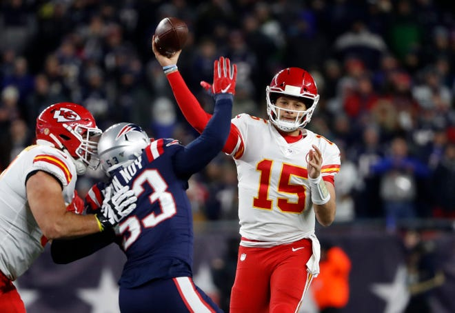 Kansas City Chiefs quarterback Patrick Mahomes (15) passes over New England Patriots middle linebacker Kyle Van Noy (53) in last year's game at Foxborough. The Patriots are expecting more unpredictability from Mahomes when they visit Arrowhead Stadium Sunday.