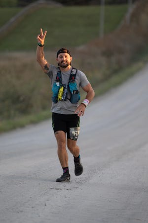 Nic Chiri competes in the Booneville Backroads Ultra-Marathon last month in Booneville, Iowa.