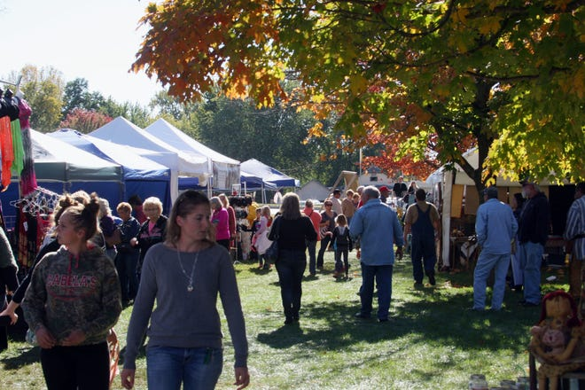 Vendors fill the downtown park Oct. 11, 2014, in Keosauqua during the Villages of Van Buren Scenic Drive Festival, which kicks off Friday.