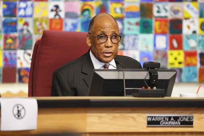 Chairman Warren Jones leads a Duval County School Board meeting in June.