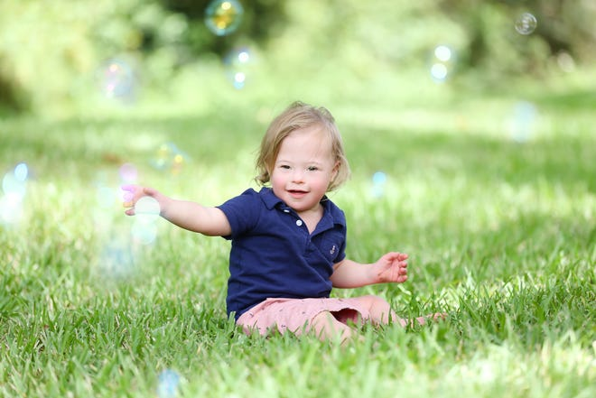 """James Daniel """"JD"""" Hennessy 2, has Down syndrome. """"JD is our happy energetic little boy. He is full of smiles and laughs,"""" said his mother, Amanda Hennessy of Jacksonville."""
