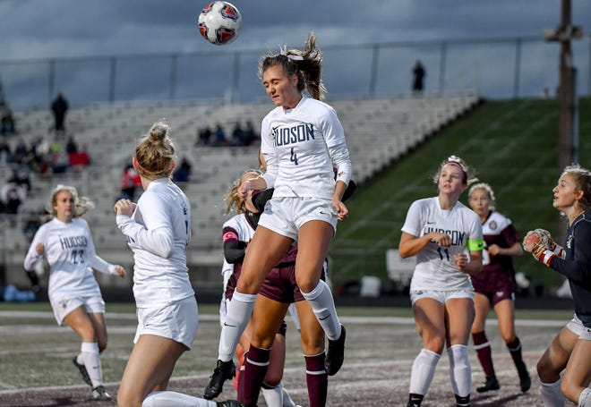 Hudson's Maddie Coates heads the ball away on a Stow-Munroe Falls corner kick during the Explorers' 1-0 loss at Stow Sept. 30