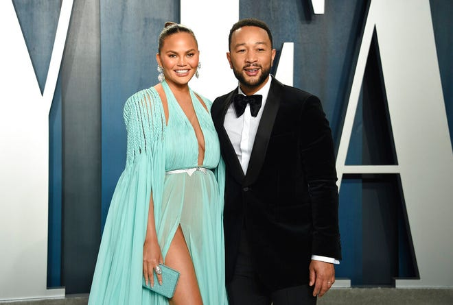 "Chrissy Teigen and John Legend arrive at the Vanity Fair Oscar Party on Feb. 9 in Beverly Hills, Calif. On Oct. 1, they revealed their ""deep pain""  over the loss of their unborn baby. Teigen announced their loss on her social media accounts, saying they were ""driving home from the hospital with no baby. This is unreal."""