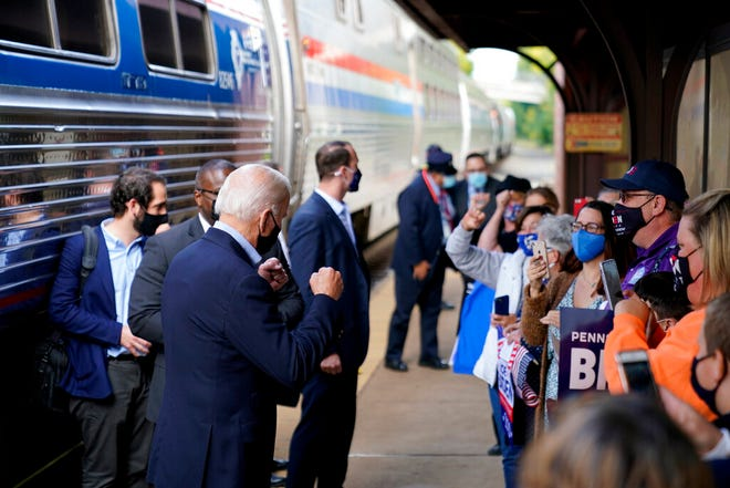 Democratic presidential candidate former Vice President Joe Biden greets supporters on the platform outside the Amtrak's Greensburg Train Station, Sept. 30, 2020, in Greensburg, Pa. Biden is on a train tour through Ohio and Pennsylvania today.