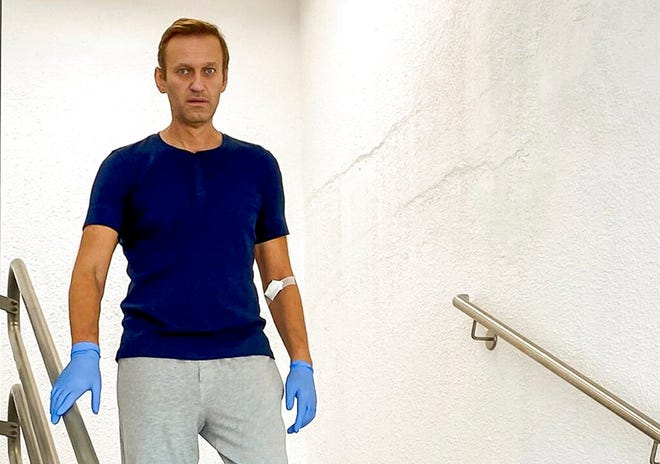 In this photo taken from a video published by Russian opposition leader Alexei Navalny on his Instagram account, Navalny walks down stairs in a hospital in Berlin, Germany, Sept. 19, 2020. Navalny, who is recovering in Germany after being poisoned in Russia by a nerve agent, accused Russian President Vladimir Putin of being behind the attack in comments released Thursday.