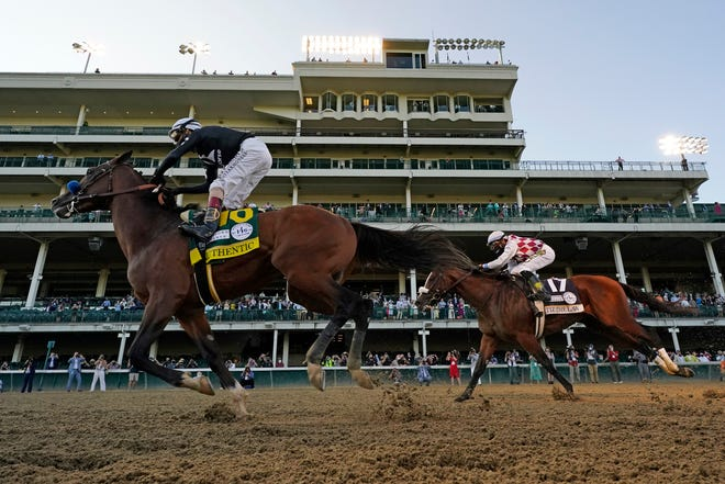 Jockey John Velazquez riding Authentic, right, crosses the finish line ahead of Jockey Manny Franco riding Tiz the Law to win the 146th running of the Kentucky Derby at Churchill Downs on Sept. 5. The colt is the favorite in Saturday's Preakness Stakes.