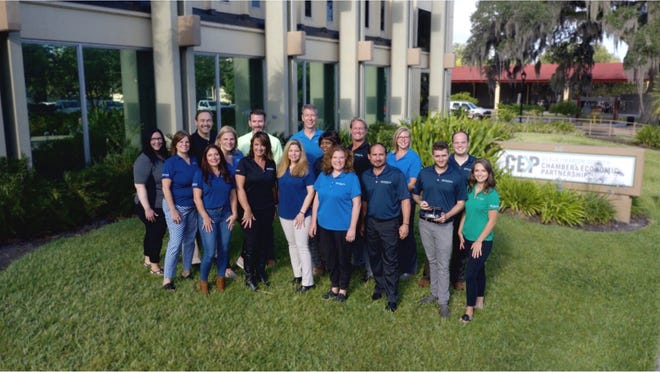 The staff of the Ocala/Marion County Chamber & Economic Partnership poses in front of the building in this handout photo. The CEP was named the top chamber in the country on Wednesday.