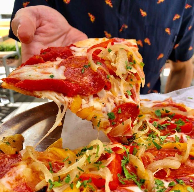 A slice of Ray's Manhattan pie at Pizzeria Sophia in suburban Delray Beach. [Provided by Pizzeria Sophia]
