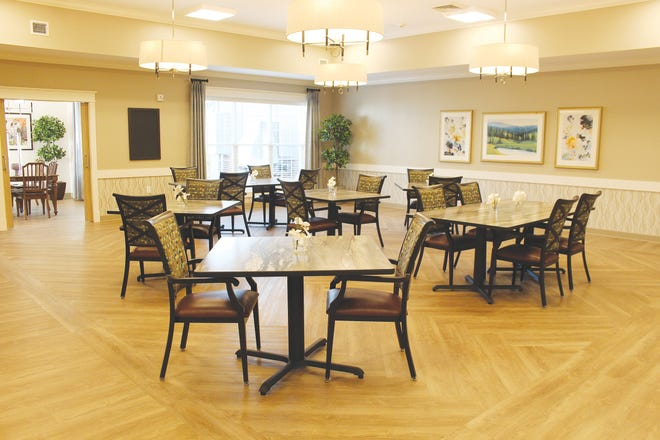 A dining area at Grand Plains Skillled Nursing Center by Americare in Pratt features spacious seating and restaurant-style ambiance.