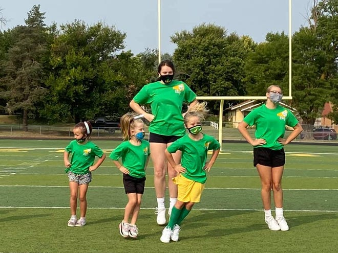Pratt High School cheerleaders led youhg Greenbacks in jumping and cheer motions during the Greenback Cheer Squad camp and performance last week at Zerger Field.