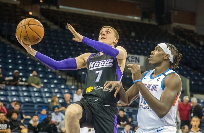 Stockton Kings' Kyle Guy, left, drives to the basket past Oklahoma City Blue's Kevin Hervey during a NBA G-League game at the Stockton Arena in downtown Stockton.  [CLIFFORD OTO/STOCKTON RECORD FILES]