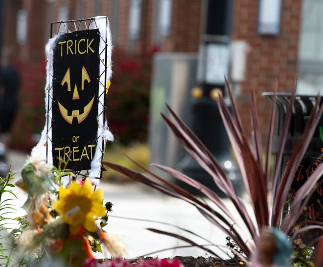 A Halloween display is set up in downtown Ravenna. Some communities are planning trick or treat events, but still have concerns about COVID-19.