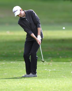 Jackson's Ben Ramold hits onto the green on the No. 2 hole at Tannenhauf Golf Course during Thursday's Federal League Postseason Tournament.