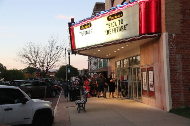 Moviegoers line up for the last night of movies at Shawnee's downtown Hornbeck, which closed for good at the end of business Sept. 29.