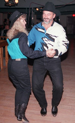 Diane and Ronnie Baggett show off their two-stepping ability at Country Music USA Saturday night in Wilmington.