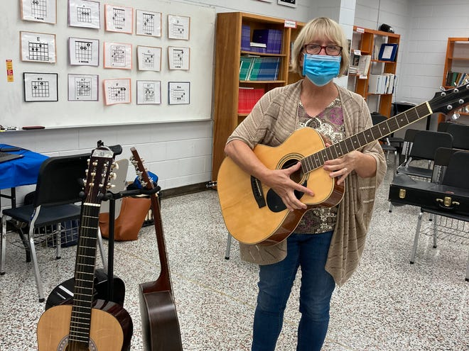 Terry Waddell, music teacher at Leland Middle School, in Leland, N.C., requested donations of guitars for her students.