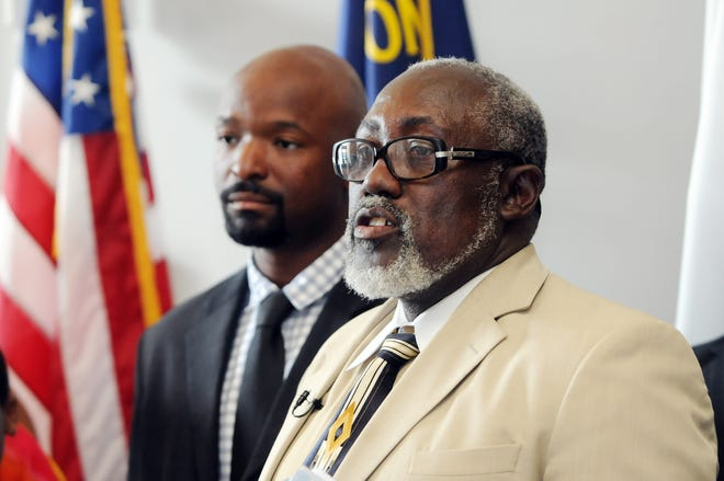 Bishop James Utley (right) President of the Resource Outreach Center, and Jeremy L. Newkirk of MBN6 conduct a press conference in the lobby of City Hall in Wilmington, N.C., Wednesday, July 23, 2014 ahead of a 3-day concert and indie artist showcase focused on preventing violence, bullying and high illiteracy rates among youths.