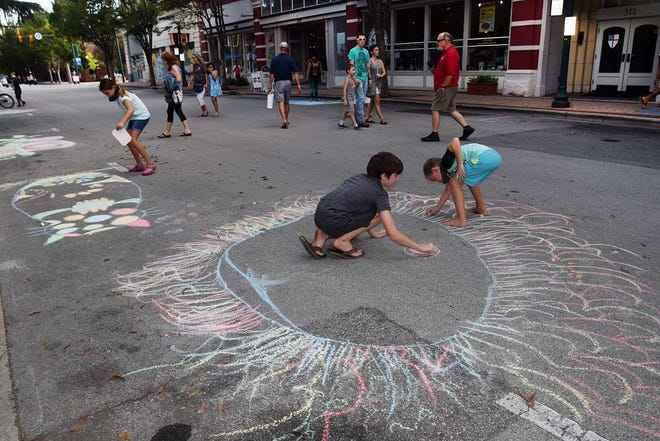 Activities such as the Craven Arts Council's Chalk Art is attracting adults and children.