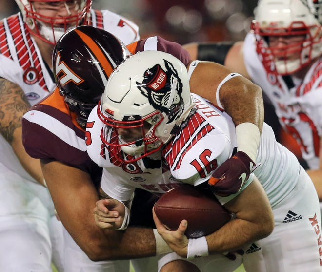 NC State quarterback Bailey Hockman (16)  was consistently pressured in last weekend's loss to Virginia Tech. Devin Leary came in at quarterback in the second half, and coach Dave Doeren hasn't named a starter for Saturday's game at Pitt.