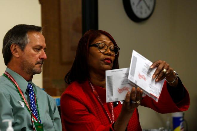Kim Barton, the Alachua County Supervisor of Elections, and Thomas Jaworski look at ballots at the Supervisor of Elections Office in Gainesville in March.