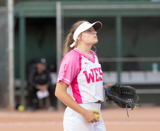 Pueblo West High School senior Hanna Winden helps with outfield practice before the Cyclones' contest against South on Sept. 28 at Salas Field.