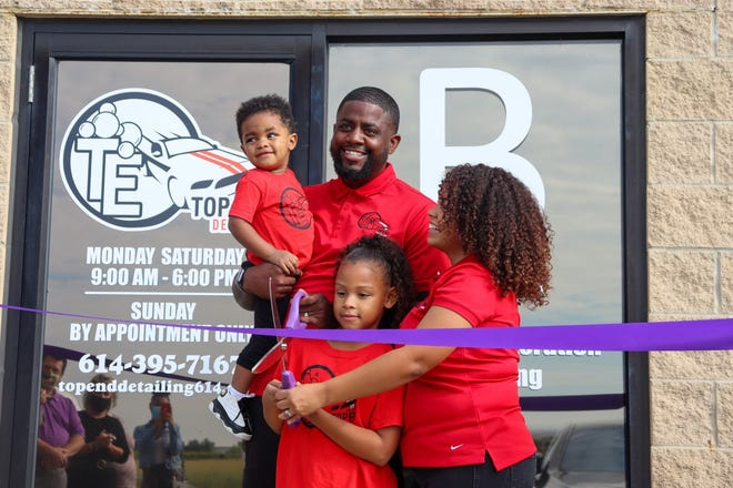 Rob and Cheyene Davis have opened a brick-and-mortar location for their business, Top End Detailing, 8120 Howe Industrial Parkway in Canal Winchester. With them at the ribbon-cutting are their children, Kayceon, 1, and Kayel, 8.