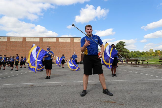 "Gahanna Lincoln High School senior drum major Gavin Waits performs with the marching band at Gahanna's Middle School East on Sept. 26. The band held a ""parking lot concert"" at East and Middle School West as a way to help kick off the annual Tag Day fundraiser, which is being conducted online this year."