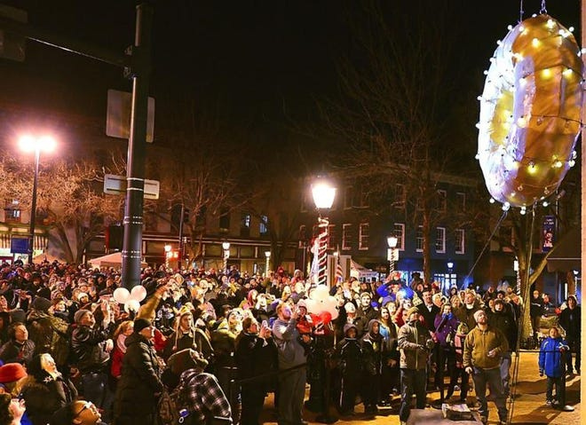 Spectators watch as the doughnut drops to mark the start of 2014 at Krumpe's Do-Nut Drop in Hagerstown's Public Square.