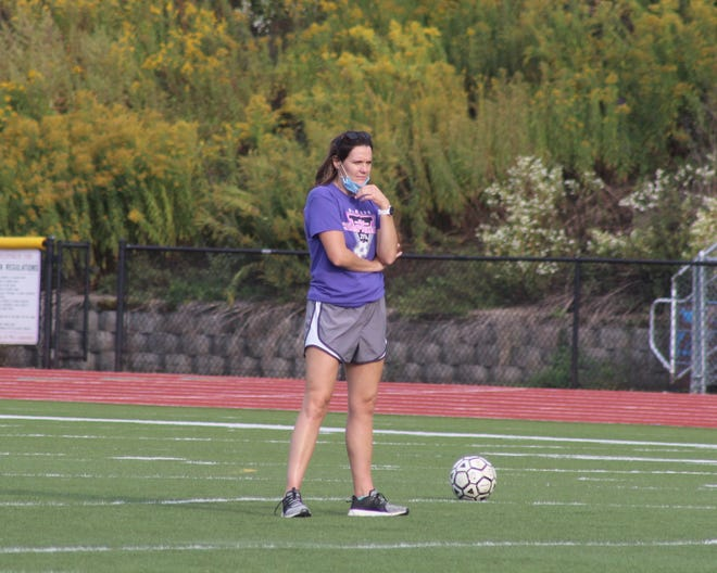 Wellsville varsity girls soccer coach and first-year athletic director Erica Aftuck watches over a recent practice.