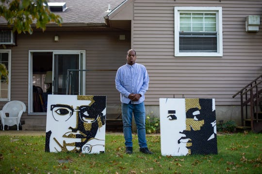 Courtney Newman poses with two of his art pieces depicting Malcolm X and Martin Luther King Jr. in Pennsauken, N.J. on Wednesday, Sept. 30, 2020. Newman used bullet shell casings as a medium for the pieces.