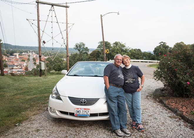 Jim and Sue Salyers stand atop Carlisle Hill in front of the Carlisle Hill Star on Sept. 22, 2020. Ever since the start of the coronavirus pandemic, the couple often drives their white convertible downtown to see the star lit up on top of the hill and are inspired by the symbolism it represents - kindness, compassion, and giving.