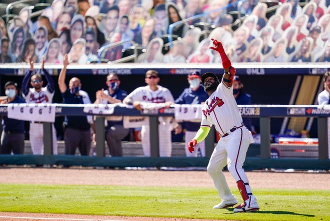 Atlanta Braves designated hitter Marcell Ozuna (20) reacts after hitting a two run home run against the Cincinnati Reds during the eighth inning at Truist Park on Oct. 1.
