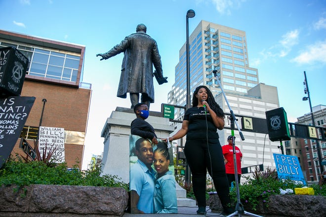"""Taylor Pennington speaks about her husband William """"Billy"""" Pennington who she says was wrongfully convicted in the 2010 robbery/killing of a worker at a Richie's restaurant. Pennington spoke during the Ohio families against police brutality rally Friday, September 25, 2020, at Piatt Park in downtown Cincinnati."""