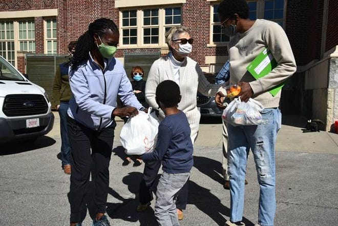 Paula Nyika-Makore, CHA board member, and Judy Mobley, CHA president and CEO, distributing meals at Westwood Elementary