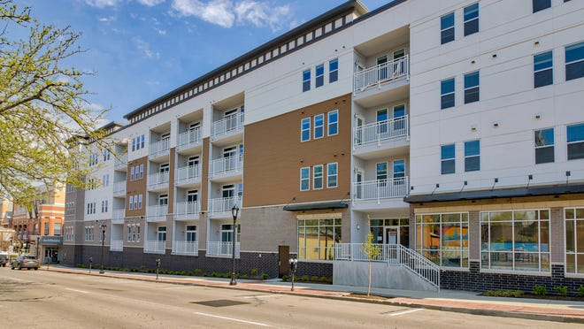 The Academy on 4th apartments in Newport, 202-units with a pool in an interior courtyard and a parking garage, has been completed, according to a Sept. 30 Newport release.