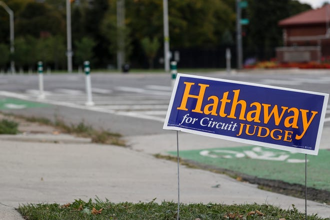 A sign promoting Nicholas John Hathaway for Wayne Circuit Court judge sits on Jefferson Avenue in Detroit on Tues., Sept. 29, 2020.