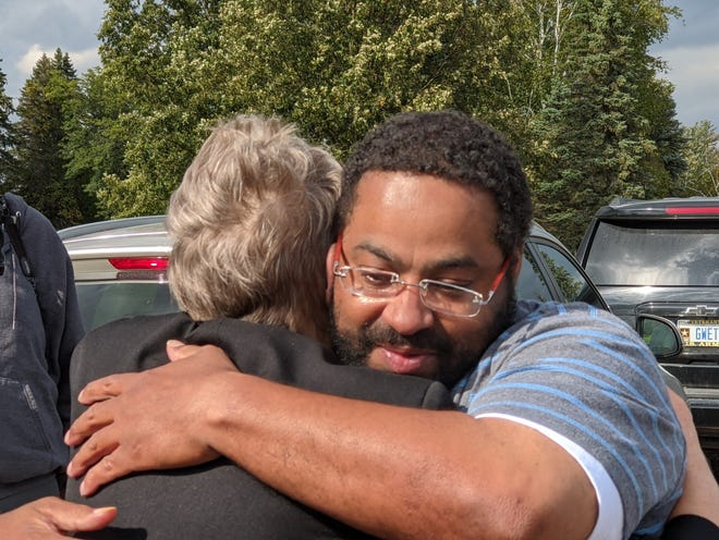 Lacino Hamilton hugs WMU-Cooley Innocence Project Director Marla Mitchell-Cichon following his release from prison Sept. 30, 2020.