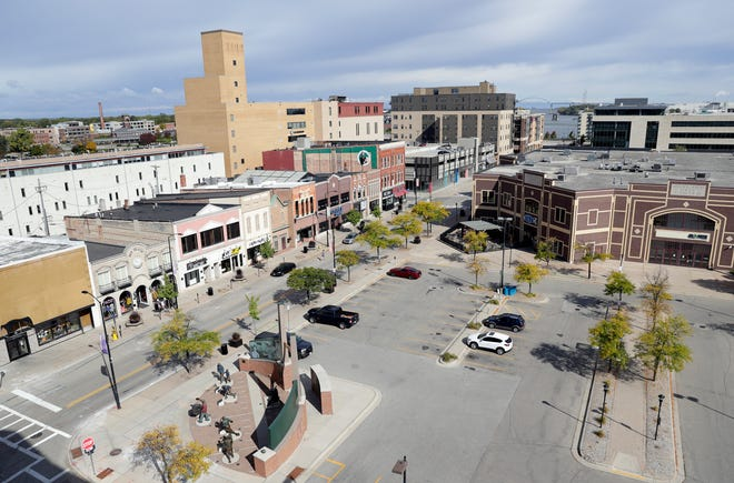 Washington Street is pictured on Sept. 29, 2020, in Green Bay, Wis. Downtown business owners say they're seeing fewer customers following a surge in coronavirus cases throughout Brown County.